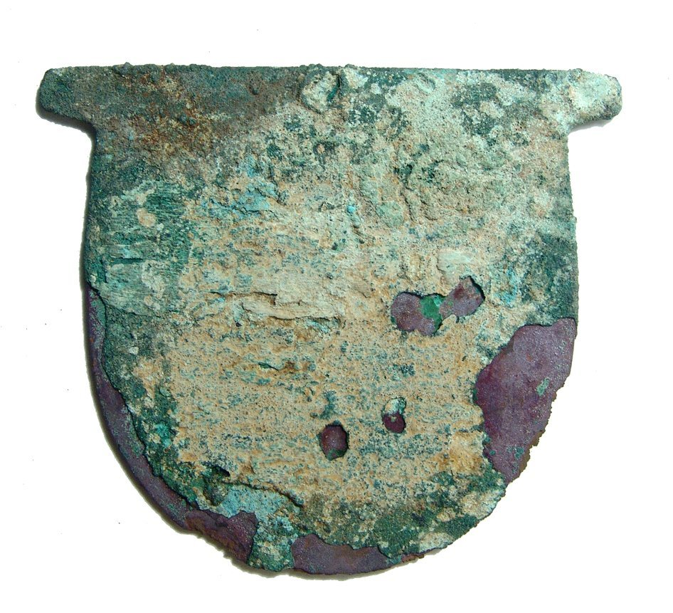 An Egyptian rounded copper axe head