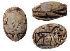 An Egyptian steatite scarab depicting a horse
