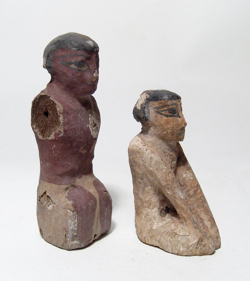 A pair of Egyptian Middle Kingdom wood figures