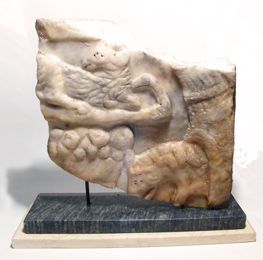 Roman marble sarcophagus fragment depicting an offering