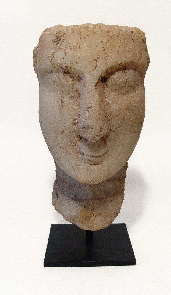 A Sabaean marble head of a man
