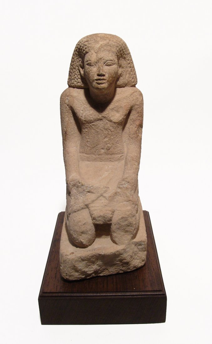 Egyptian limestone figure a kneeling scribe