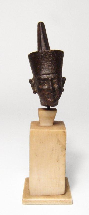 A choice Egyptian bronze head of Neith, Dynasty 26