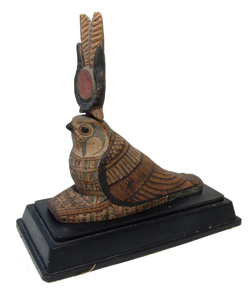 A beautiful Egyptian wooden falcon, Late Period