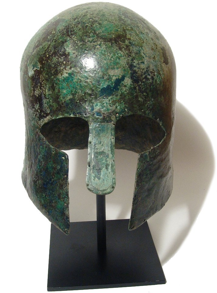 A Greek  bronze helmet of Corinthian type , 6th Century