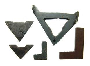 A lot 5 Egyptian Hematite architectural tool amulets