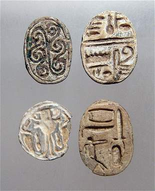 4 Egyptian steatite scarabs and a scaraboid