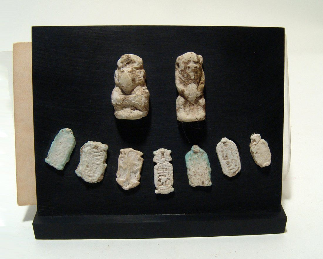 Mounted set of Egyptian faience ring bezels and amulets
