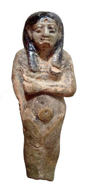 An Egyptian faience bi-color statuette with royal