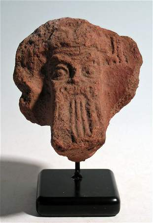 Detailed terracotta pot-support with mask of