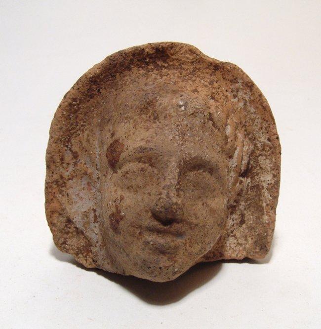An Etruscan terracotta veiled male head