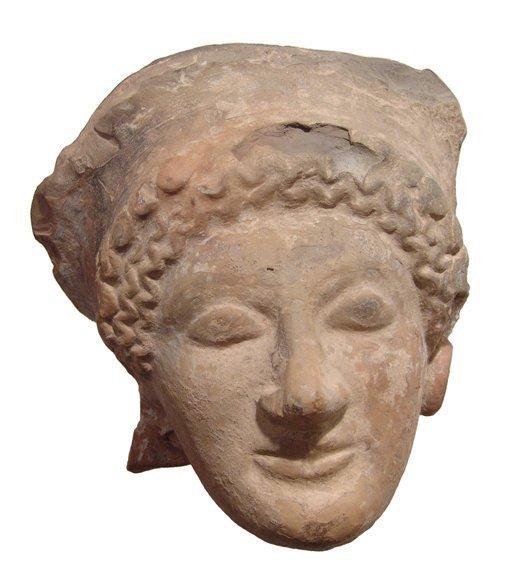 Attractive terracotta female head, c. 5th Century BC