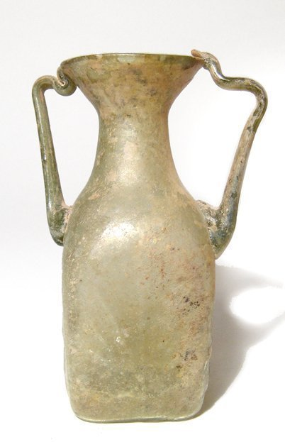 Roman pale yellow glass bottle, c. 2nd - 3rd Century AD