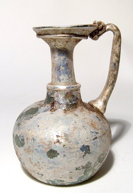 A choice Roman glass handled bottle with gorgeous