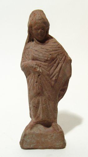 An Attractive Greek Terracotta Figure Of A Robed Woman