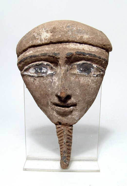 An Egyptian wood 'Mummy' mask, Late Period