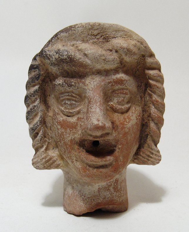Greek terracotta fountain or spout head in the form of