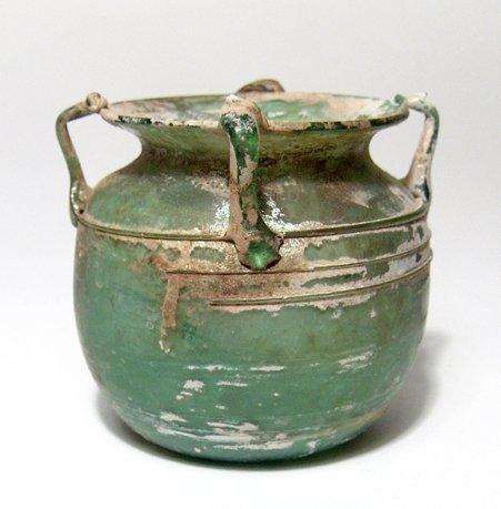 A fantastic Roman green glass vessel