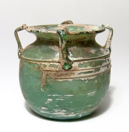 A fantastic Roman green glass vessel