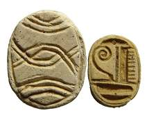 A lot of 2 Egyptian steatite scarabs.