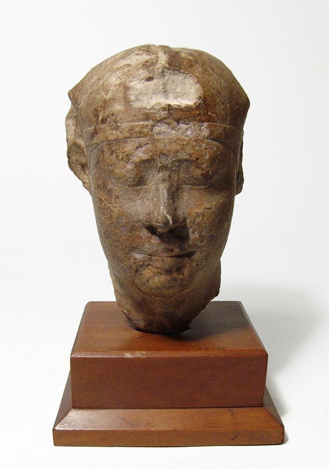 Egyptian limestone head of a pharaoh