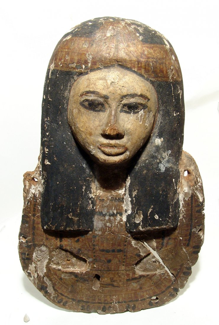 Fantastic upper portion from an Egyptian wood coffin