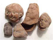 A lot of 5 Egyptian terracotta heads, Graeco-Roman