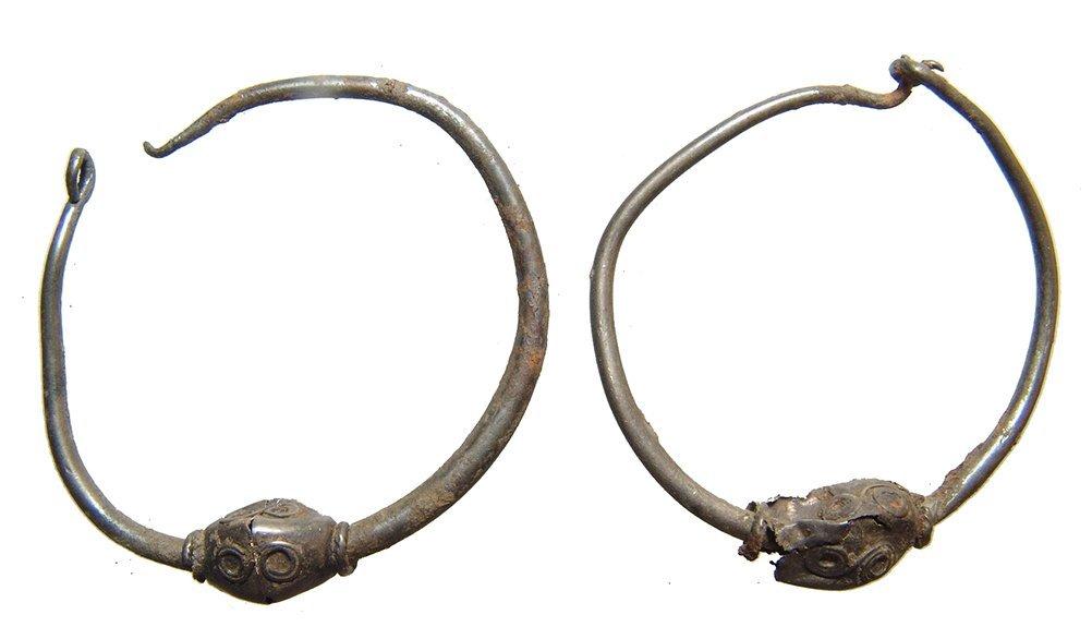 A pair of Hellenistic silver loop earrings, Egypt