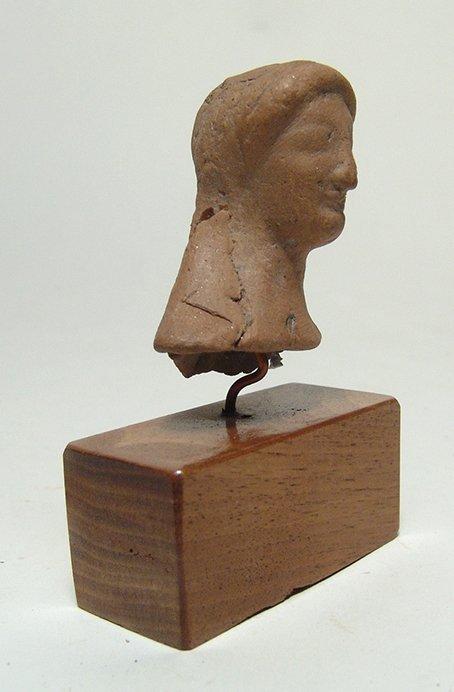 A Greek terracotta bust of a Kore - 2