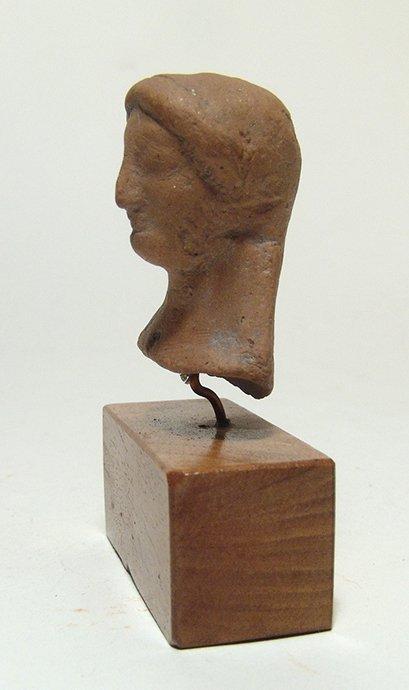 A Greek terracotta bust of a Kore - 3