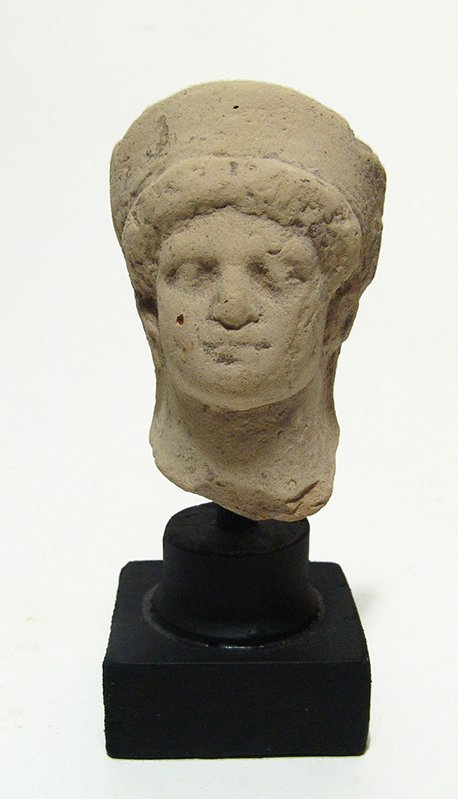 A Greek terracotta head of a goddess