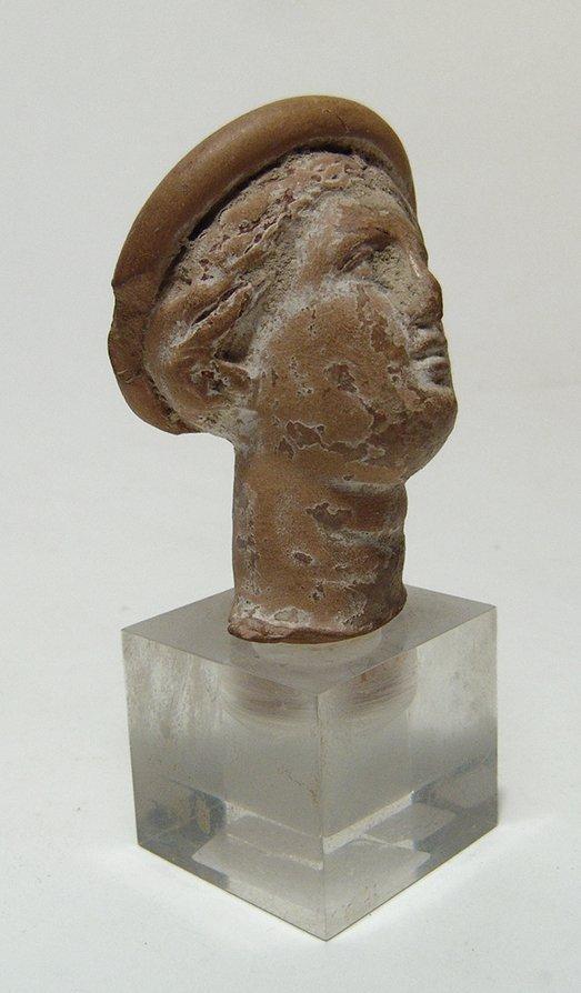 A Greek terracotta head of a woman