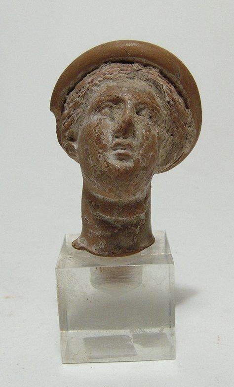 A Greek terracotta head of a woman - 3