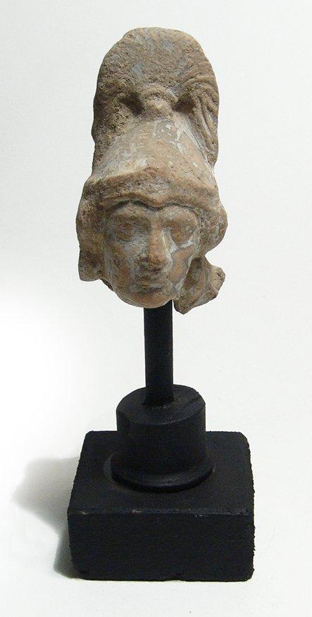 A Greek terracotta head of an Amazon