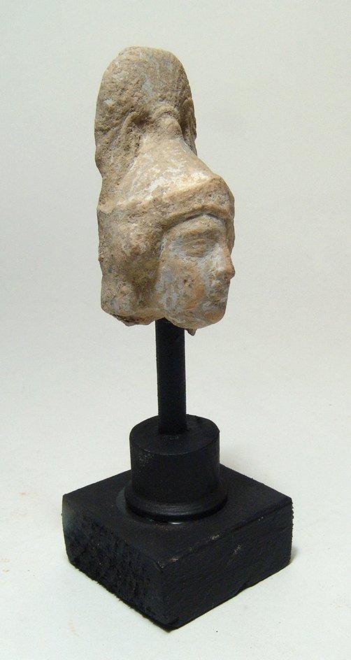 A Greek terracotta head of an Amazon - 2