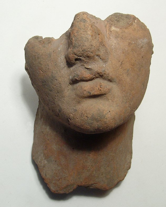 An attractive Hellenistic terracotta male portrait