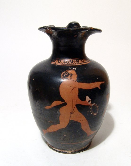 An Attic red-figure oinochoe depicting a satyr