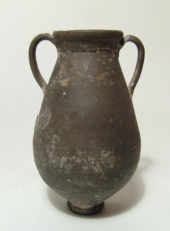 A Greek black-glazed amphora
