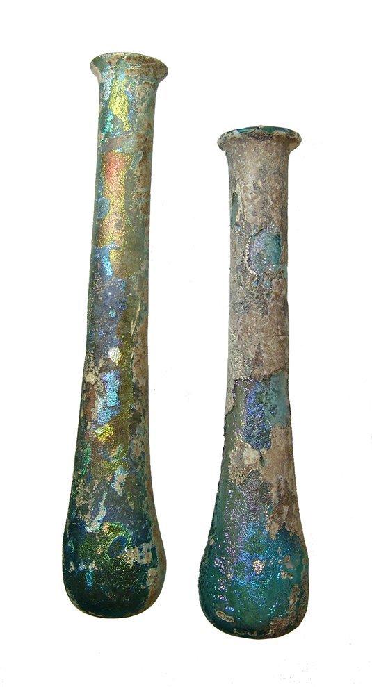 A pair of Roman blue-green glass unguentariums