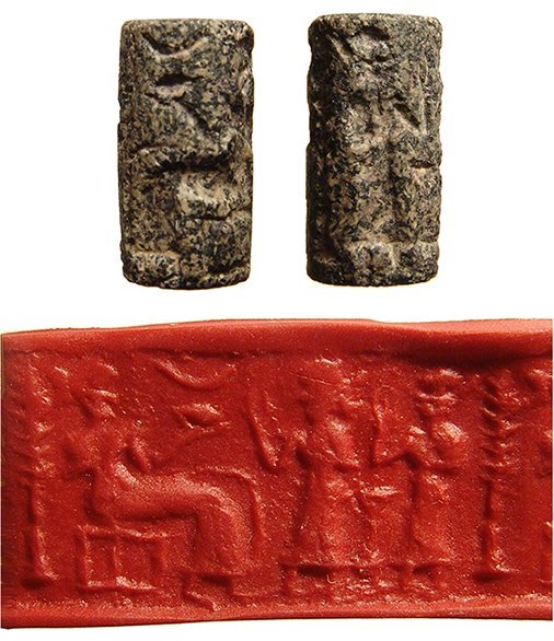 A Near Eastern speckled granite cylinder seal