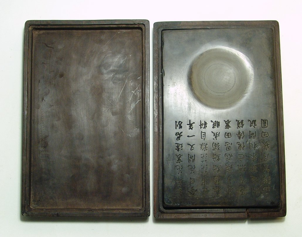 A nice Chinese ink stone with carved wood box