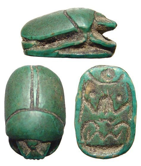 An Egyptian green faience scarab, Late Period