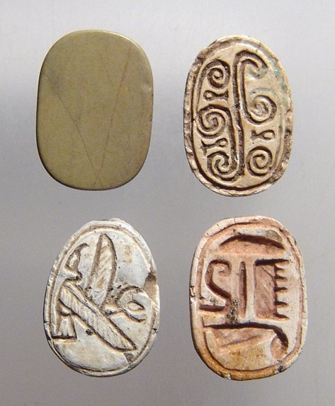 A lot of Egyptian scarabs and a scaraboid