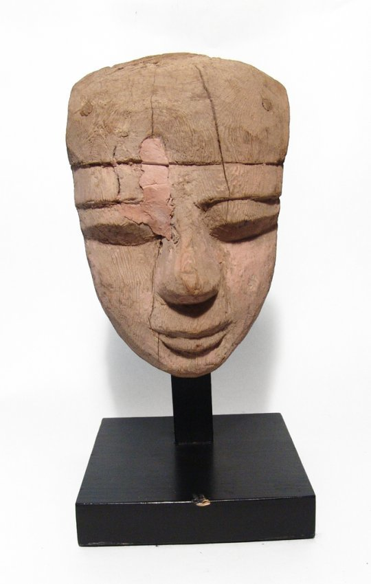 An Egyptian wooden mummy mask, Late Period
