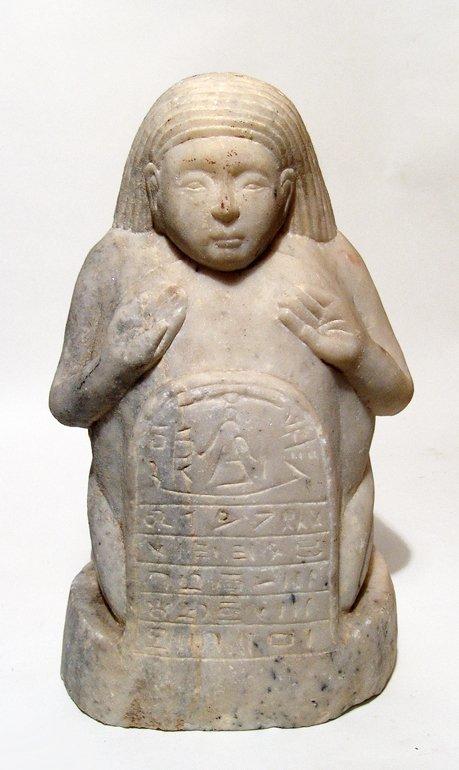 A Sabaean marble sculpture of a kneeling male