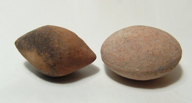 A pair of ancient clay sling bullets - 2