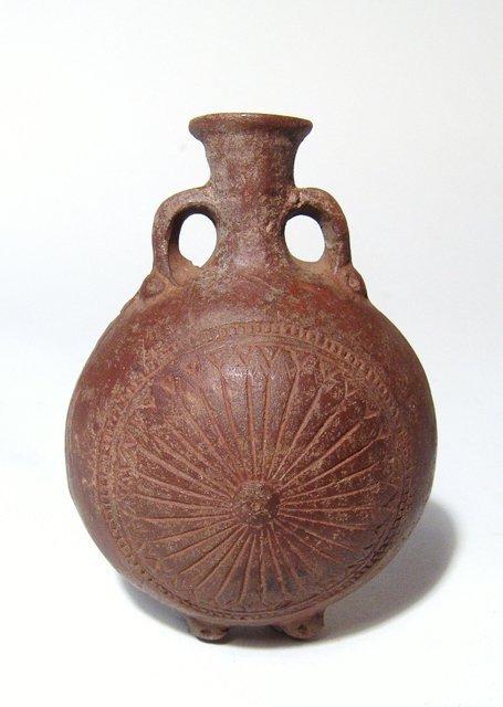 A Roman orange-ware terracotta flask, Egypt