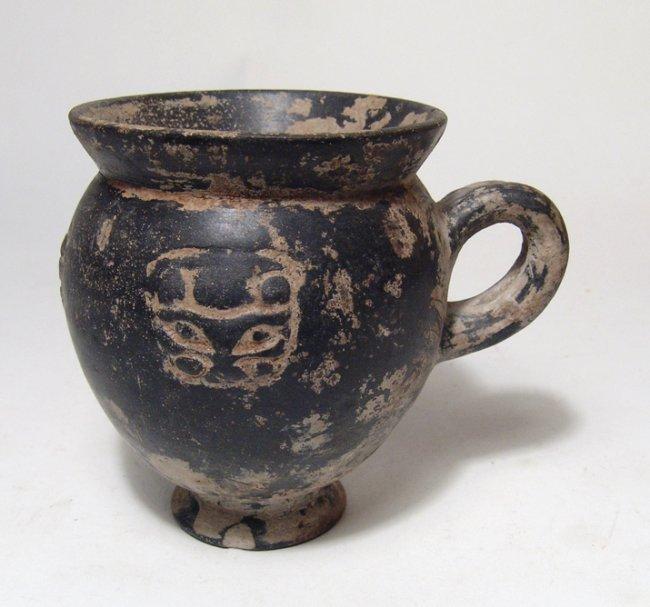 A Bucchero pesante mug with 4 lion masks - 3