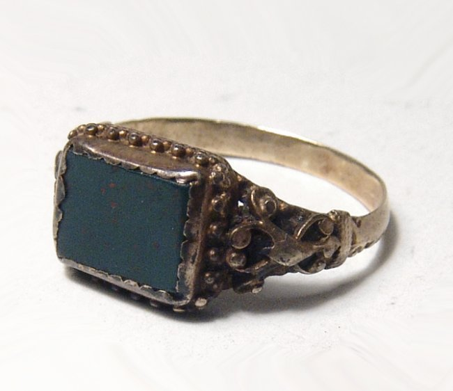 A gold antique ring with square bloodstone