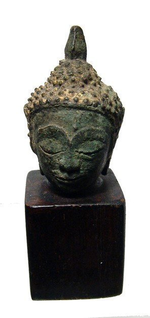 A gilded bronze head of Buddha